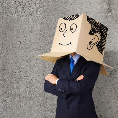 Man wearing a cardboard box on his head with a face drawn on to represent not being his true self