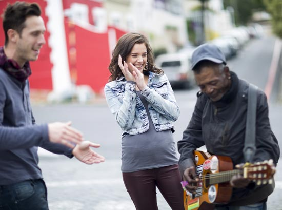 Couple listening to a street musician and enjoying their hearing